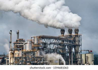 Chemical factory with smoke stack. Smoke emission from factory pipes. Ecology and environmental protection problems, air pollution