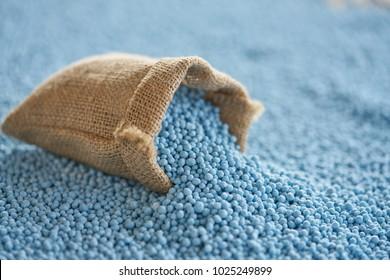 chemical fertilizer in gunny sack and blur background. NPK  fertilizer for plants.