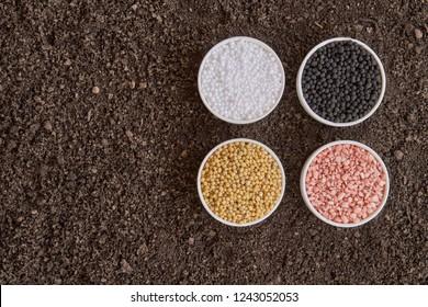 Chemical fertilizer on soil background