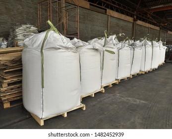 Chemical fertilizer Urea Stock pile jumbo-bag in warehouse waiting for shipment.