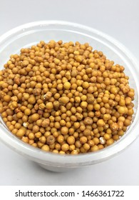 Chemical fertilizers in yellow color with the main nutrient, potassium, phosphorus and nitrogen are used to nourish various trees.