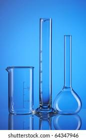 Chemical flasks over blue background