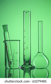 Chemical flasks over green background
