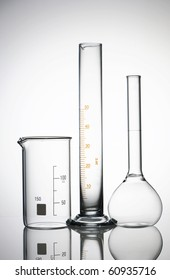 Chemical flasks over white background