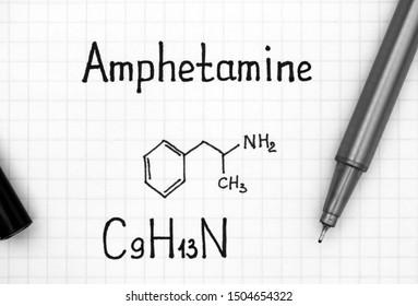 Chemical formula of Amphetamine with black pen. Close-up.
