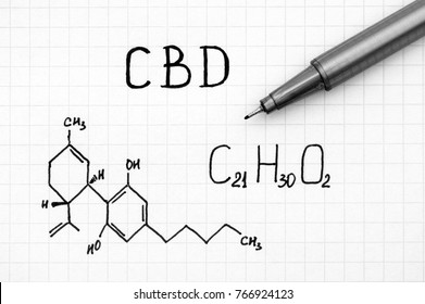 Chemical formula of Cannabidiol (CBD) with black pen. Close-up.
