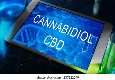 the chemical formula of cannabidiol on a tablet with test tubes