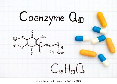 Chemical formula of Coenzyme Q10 with some pills. Close-up.