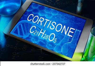the chemical formula of Cortisone on a tablet with test tubes