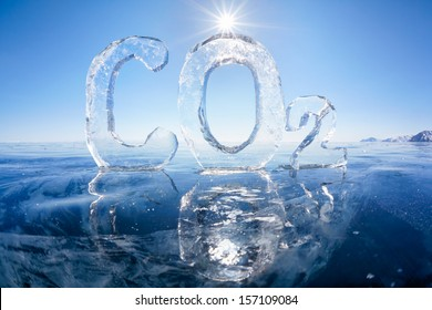 Chemical formula of greenhouse gas carbon dioxide CO2 made from ice on winter frozen lake Baikal under blue sky and Sun rays