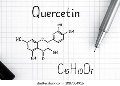 Chemical formula of Quercetin with black pen. Close-up.