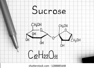 Chemical formula of Sucrose with black pen. Close-up.