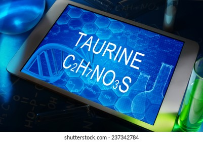 the chemical formula of Taurine on a tablet with test tubes