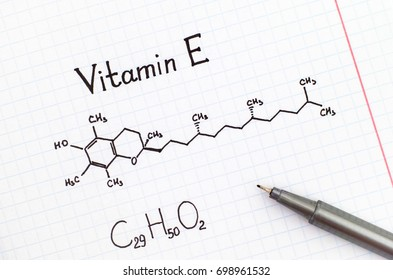 Chemical formula of Vitamin E with black pen.