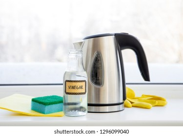 Chemical free home cleaner product concept. Using natural destilled acid white vinegar in electric kettle to remove boil away the limescale. Descaling a kettle, remove scale concept.
