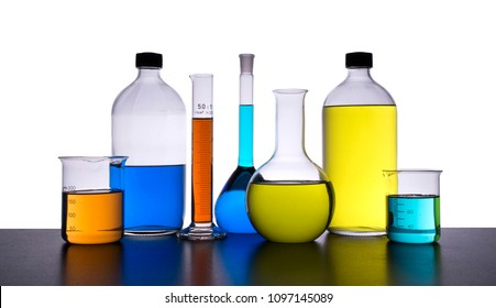 chemical glasses, filled with colored liquids, gradient background