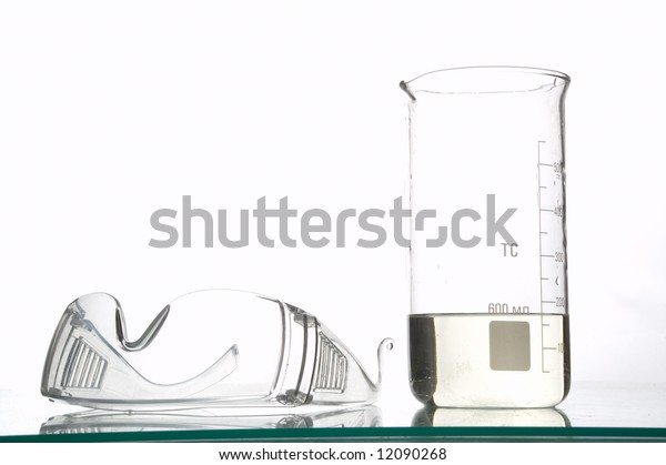 chemical glasses and flask, filled with liquids, white background