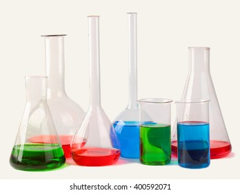 Chemical glassware with colorful liquids isolated on white background