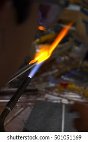 Chemical glassware with fire background