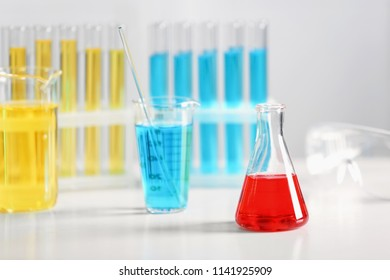 Chemical glassware on table in laboratory