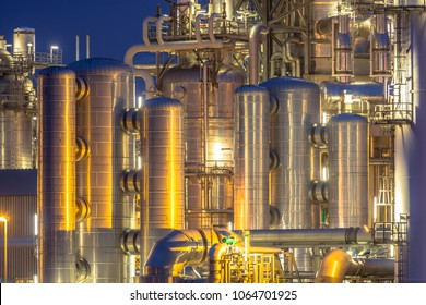 Chemical industry detail installation background at night. Petrochemical close up of factory.