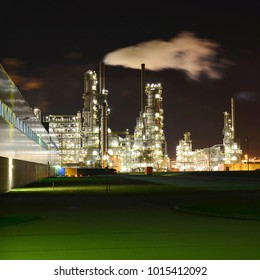 Chemical industry plant at night - building of a factory for the production of gasoline