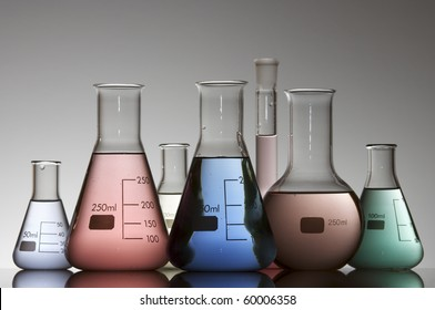 chemical laboratory flasks containing liquid shiny color