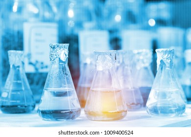 Chemical laboratory with grass and liquid substance. Research and development concept