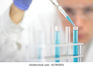 Chemical laboratory worker during biochemical analysis.