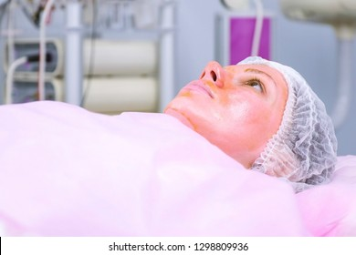 Chemical peeling o the woman's face. Cleaning the face skin and lightening freckles skin in clinic.