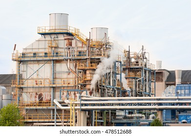 Chemical plant of a factory. Smokestacks ,pipes and tank.