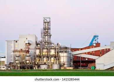 Chemical plant like part of salt mine in evening light.