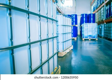 Chemical production. Plastic containers in stock. Warehouse chemicals. Blue barrels and white plastic containers. Pharmaceuticals.