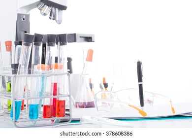 Chemical protective glasses, file work and test tubes in the laboratory.