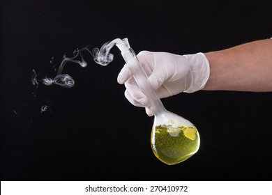 Chemical reaction in volumetric flask glass kept in the hands of scientist