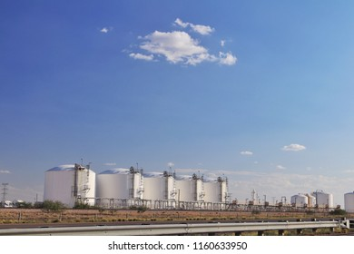 chemical storage tanks and blue sky