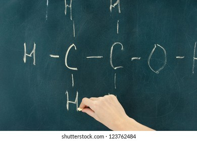 Chemical structure formula written on blackboard with chalk.