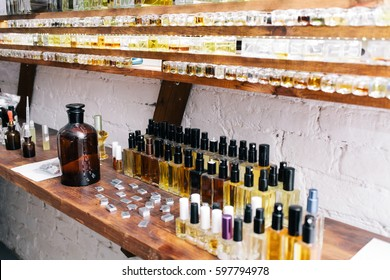 Chemical worker, Chemistry, Experiment, Vials. Close up color bottles on the shelf in old perfume laboratory. Flasks and examples of odor in the perfume shop.