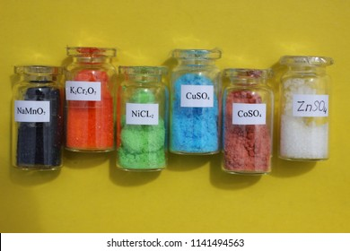 Chemically pure reagents for inorganic chemistry: black sodium permanganate, orange potassium dichromate, green nickel chloride, blue copper sulfate, red cobalt sulfate, white zinc sulfate.