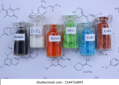 Chemically purified salts for analytical chemistry: black sodium permanganate, white zinc sulfate, orange potassium dichromate, green nickel chloride, blue copper sulfate, brown cobalt sulfate.