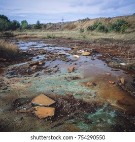 Chemicals leaching to the surface on land polluted with buried toxic waste, West Midlands