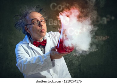 Chemist blowing in his experiment to put off explosion