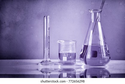Chemist formulating dangerous solution substances, Scientist with equipment and science experiments, Laboratory glassware containing toxic chemical liquid.