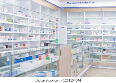 At chemist, Medicines arranged in shelves, Pharmacy drugstore retail Interior blur abstract background with healthcare product on medicine cabinet.