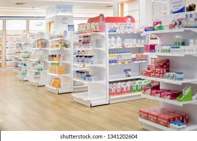 At the chemist, Medicines arranged in shelves, Pharmacy drugstore retail Interior blur abstract backbround with medicine healthcare product on cabinet with neon light.