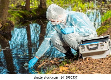 chemist researcher ecologist produces water from a forest lake