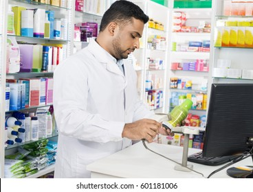 Chemist Scanning Barcode Of Product At Counter