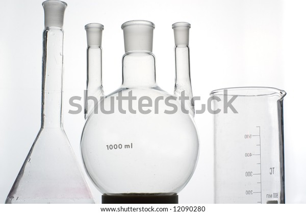chemistry beaker on grey background
