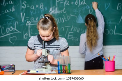 Chemistry classes. Educational experiment. Girls classmates study chemistry. Microscope test tubes chemical reactions. Pupils at chalkboard chemistry lesson. Laboratory practice. Fascinating science.