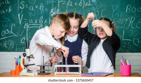 Chemistry equipment. students doing experiments with microscope in lab. Happy children. Chemistry lesson. Chemistry education. Little kids learning chemistry in school lab. Research and development.